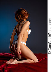 Beauty woman with perfect body in white lingerie