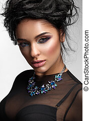 Beauty Woman with Perfect Colourful Makeup and luxury accessories