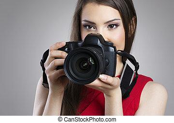 Beauty woman with photo camera