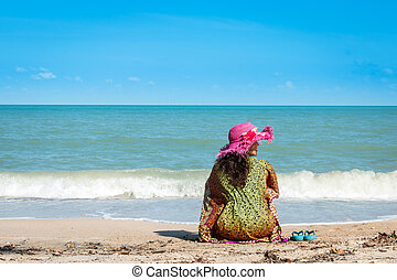 beauty women sitting at the beach