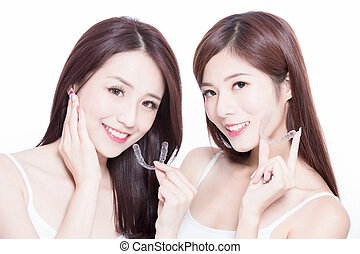 two beauty skincare women take invisible braces on the white background
