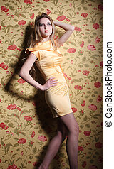 Beauty young blond girl in yellow dress