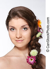 Beauty young brunette girl with flowers