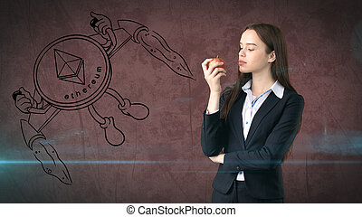 Beauty young business woman standing near sketches of Ethereum crypto currency coin. Business concept of Ethereum icon.