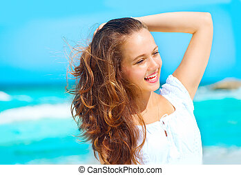 Beauty young healthy woman enjoying vacation over ocean background. Caribbean holidays