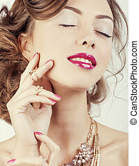 beauty young luxury woman with jewellery, rings, nails close up