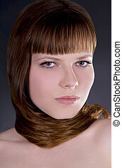 beauty young pretty girl with straight hair over dark
