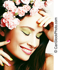 Beauty young real woman with flowers and make up closeup, lifestyle people