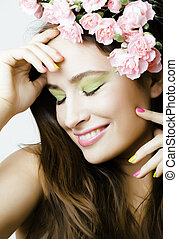 Beauty young real woman with flowers and make up closeup, spa isolated