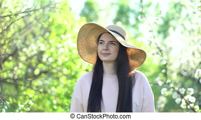 Beauty young woman enjoying apple blooming spring orchard