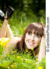 Beauty young woman relaxing in the grass