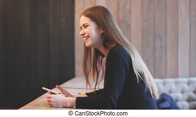 Beauty young woman sitting in cafe