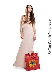 Beauty young woman walk in rose dress
