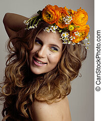 Beauty young woman with flowers and make up close , real spring  girl