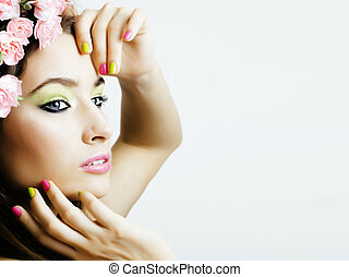 Beauty young woman with flowers and make up close up, real spring beauty girl floral pink manicure