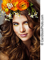 Beauty young woman with flowers and make up close up, real spring beauty