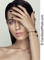 Beautyful girl with nude make up and wooden accessories