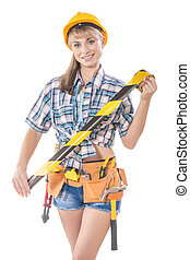 beautyful sexy female construction worker holding caution tape