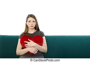 Beautyful woman embracing a heart