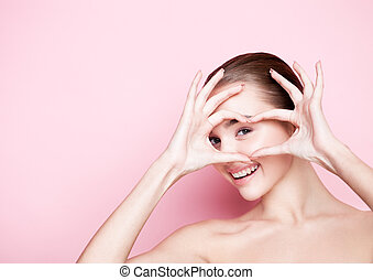 Beautyl girl natural makeup spa skin care and gorgeous smile on pink background