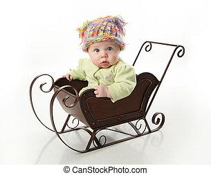 bebê senta-se, em, um, trenó