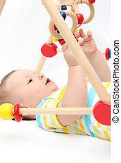 bebê, tocando, brinquedos