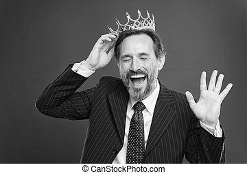 Become king ceremony. I am just superior. Award and achievement. Feeling superiority. Being superior human. Man bearded guy in suit hold golden crown symbol of monarchy. Superior and narcissistic.