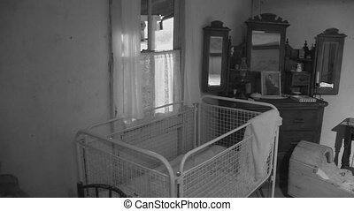 Bed and a crib in black and white - A medium shot of bed and...