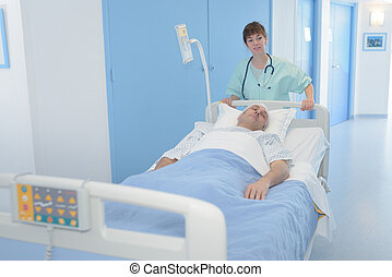 bed and patient in the hospital with nurse