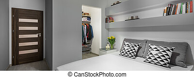 Bed and wardrobe in bedroom