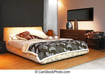 Interior of modern bedroom with double bed