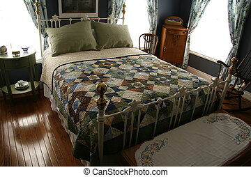 Bed and Breakfast Room with iron bed and quilt