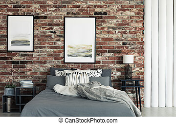 Bed by brick wall