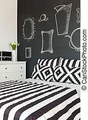 Bed by the blackboard