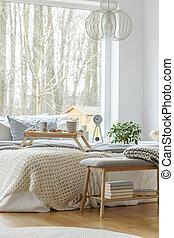 Bed in bedroom interior