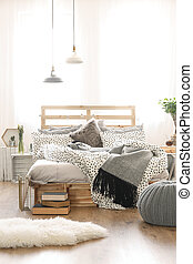 Bed in stylish bedroom - Wooden bed in stylish bedroom with...