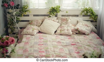 bed in the bedroom with flowers rustic style