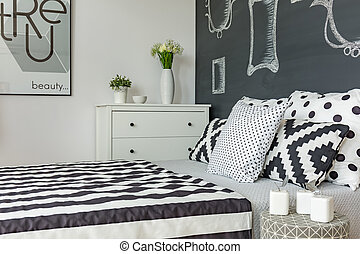 Bed in white and black room
