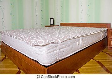 Bed mattress with topper. Bedroom interior - Bad matress...