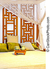 Bed - Oriental style wooden bed with white baldachin