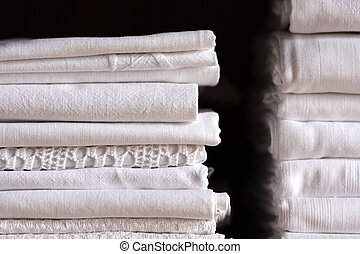 Bed sheet pile and dark background