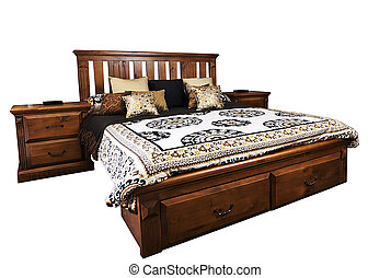 Bed - Beautiful bedroom setting with a woodern bed and side...