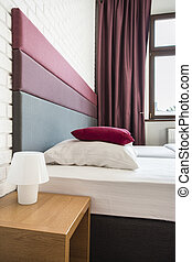 Bed with colourful headboard - Twin bed in hotel with ...