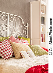 Bed with decorative pillows - Bed with decorative metal...