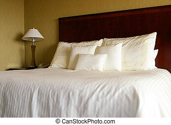 Bed with white pillows and sheets
