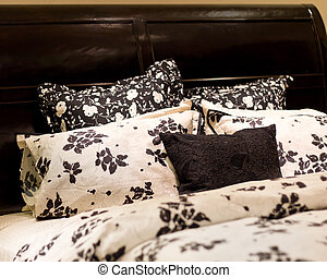 Bedding - Fluffy pillows against black and white...