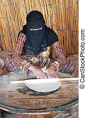 african bedouin woman make bread at home