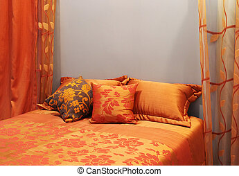 Bedroom decorated in shades of orange - home interiors