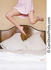 Bedroom Excitement Too - A young woman jumps excitedly on a ...