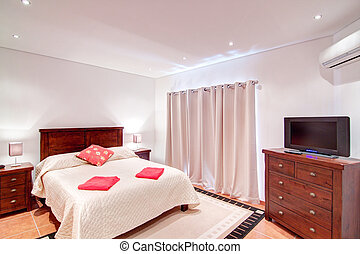 Bedroom for two people with a TV. In Decoration.